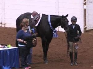 Mallory poses with her horse after winning in the Working Hunter