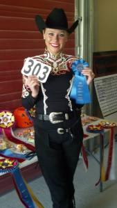Megan Krug poses with her blue ribbon