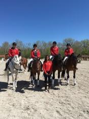 Dressage seniors Kelsey Poleyeff, Elizabeth Foster, Natalie Davis, and Kirsten Drew with Coach Courtney Previte